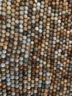 Perline di diaspro Paesaggio A da 6mm su filo da 40cm