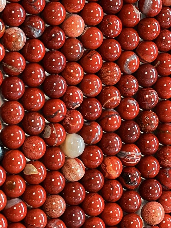 Perline di diaspro rosso AB da 8mm su filo da 40cm