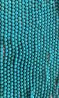Turquoise natural tinted Howlite A 10mm pearls on string