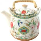 Porcelain white teapot with colored flowers