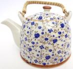 White chineese porcelain teapot with blue flowers