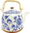 Porcelain white teapot with blue leaves